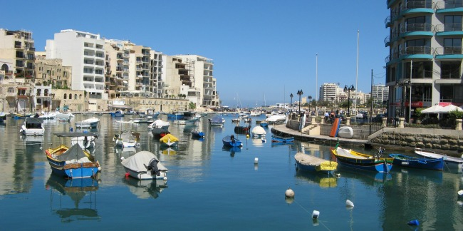 Peak summer time at St. Julian's bay Malta. Calm weather and clear sky