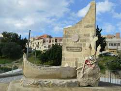13th December monument at the centre of Marsa road