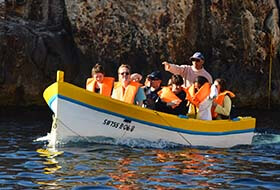 Tourists going to Blue Grotto caves