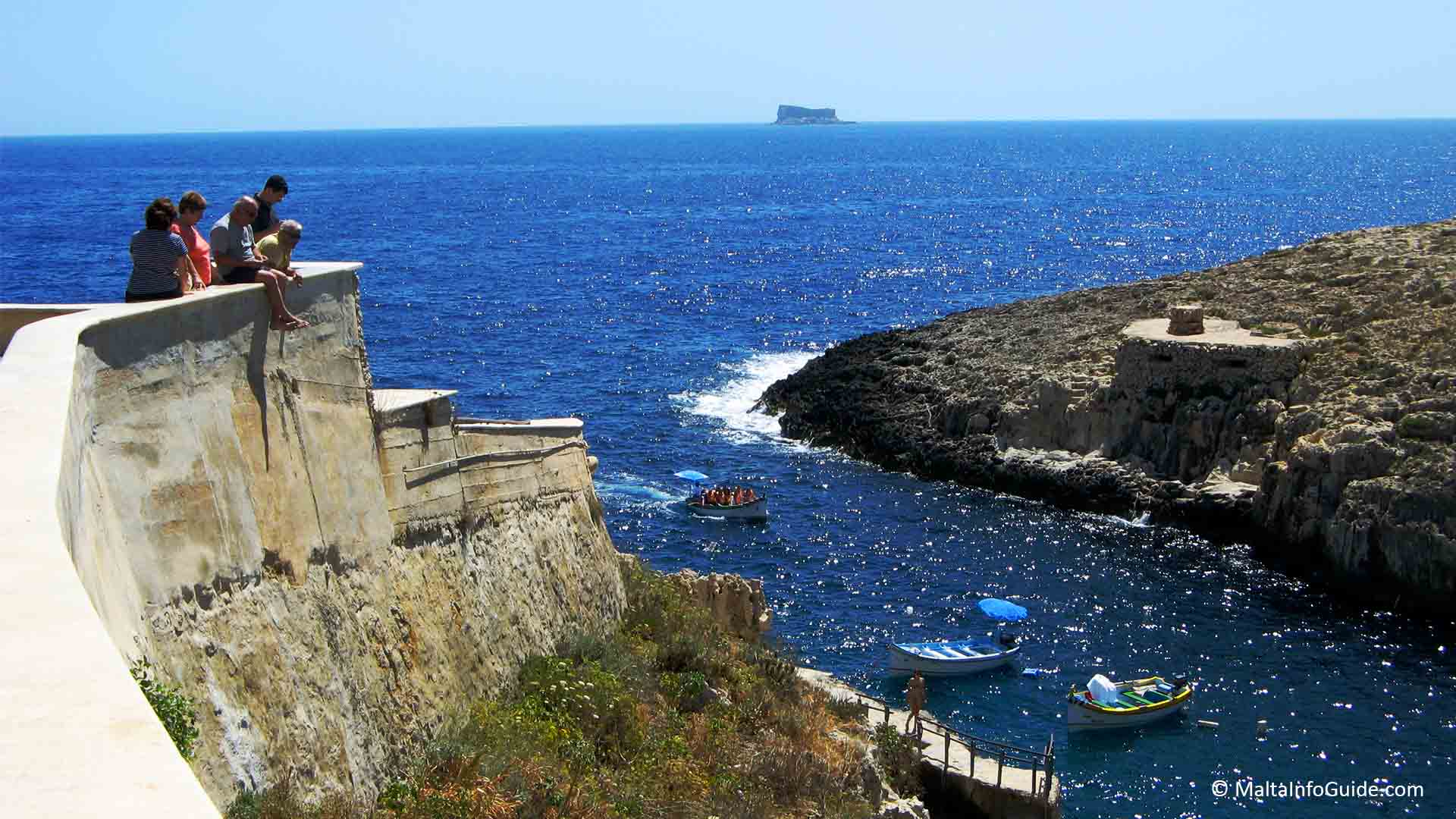 Wied iz-Zurrieq bay entrance with a fantastic view of the small island of Filfla