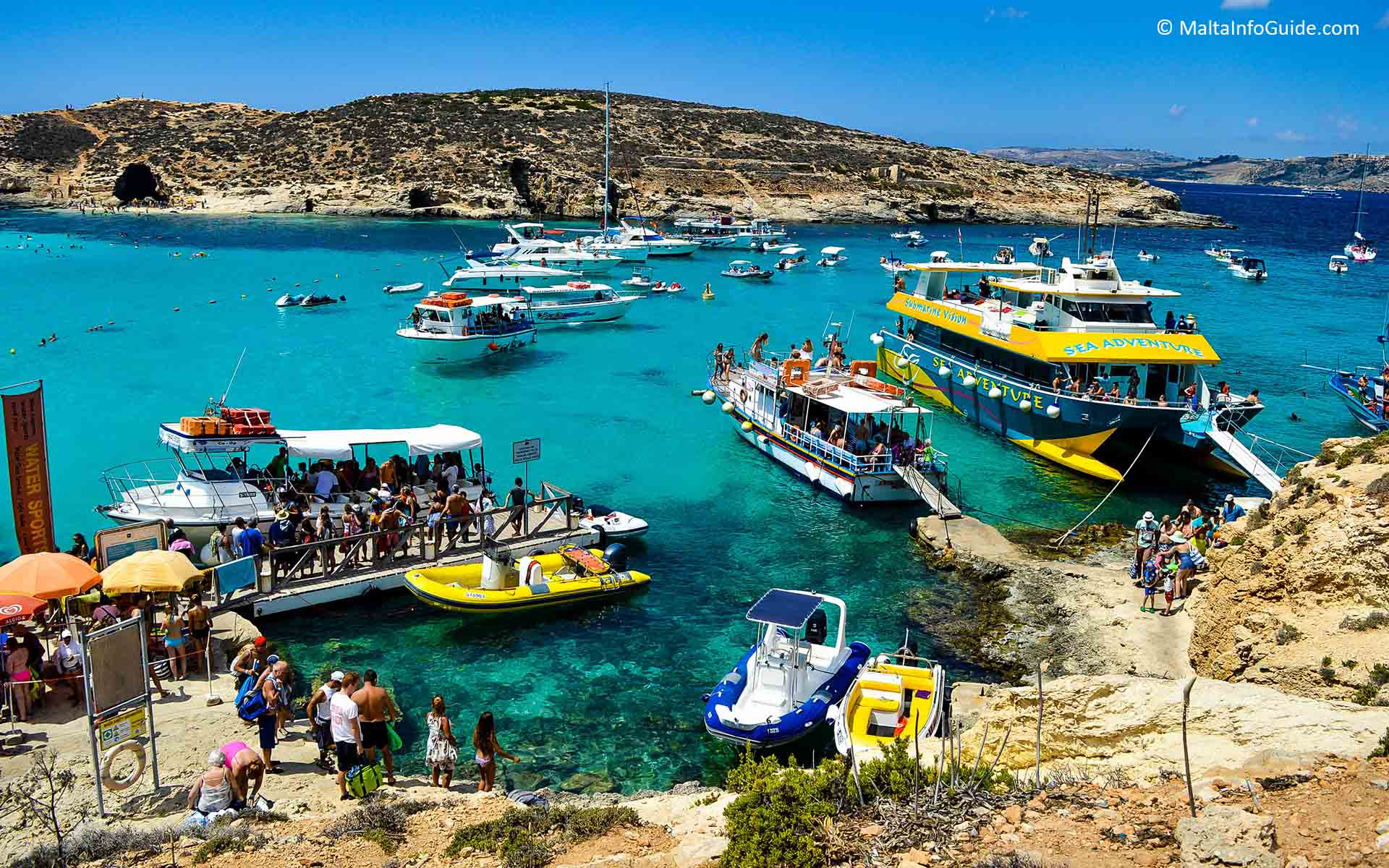 People visiting the Blue Lagoon Comino during summer