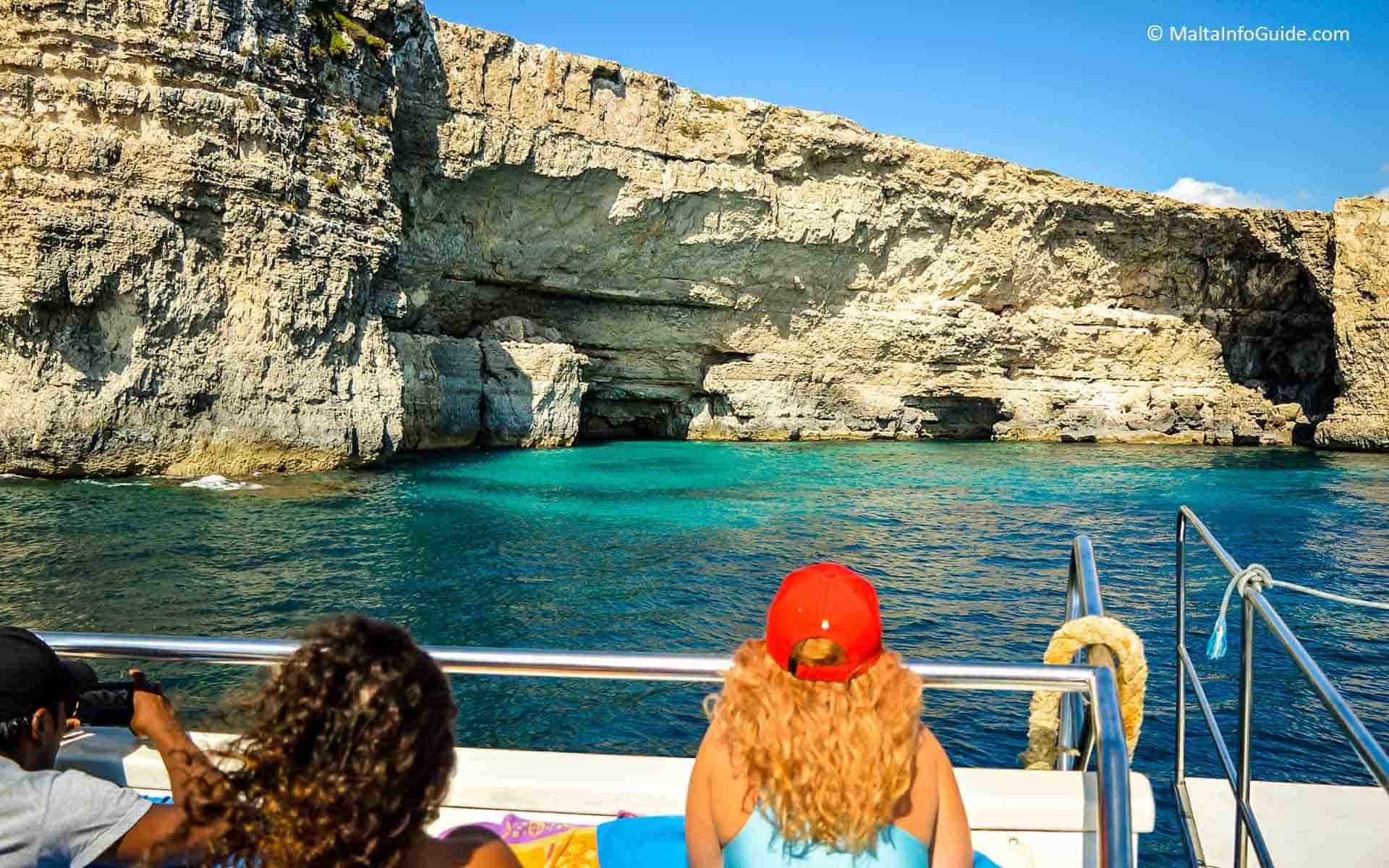 Catamaran approaching Count of Monte Cristo Cave in Malta