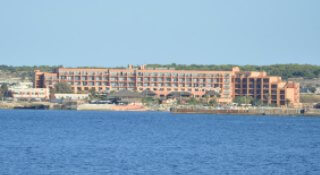 Ramla Bay Resort hotel located in a wonderful secluded peninsula facing Comino and Gozo islands at Mellieha Malta