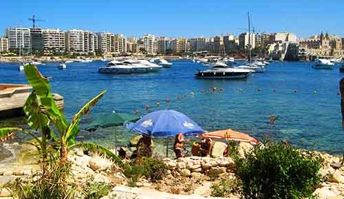 St.Julian's Beach with Sliema promenade in the background