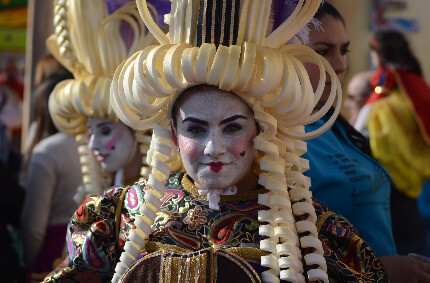 A lady wearing a Malta Carnival Costume during the defile